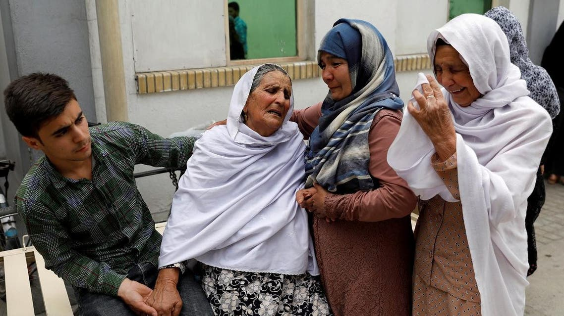 Relatives of the victims mourn at a hospital after a suicide attack in Kabul. (Reuters)