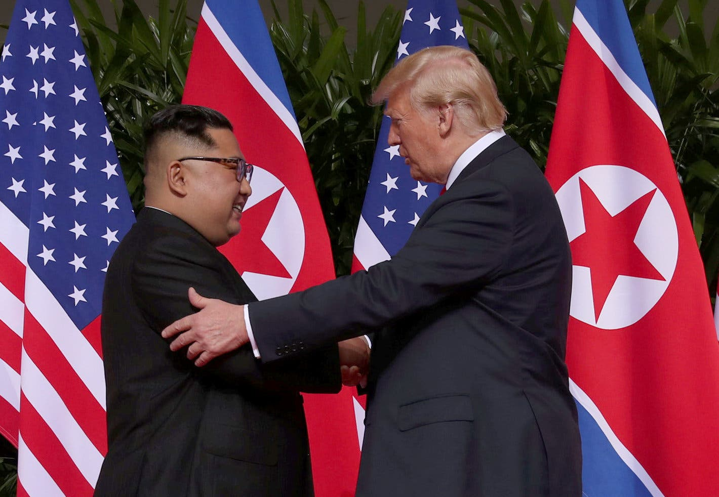 U.S. President Donald Trump shakes hands with North Korean leader Kim Jong Un at the Capella Hotel on Sentosa island in Singapore. (Reuters)