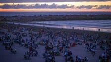 Moroccans break Ramadan fast on beach with song, dance, food