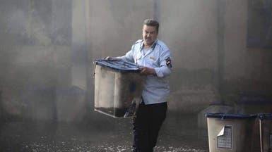 شبهات حول شرطي عراقي ظهرت صورته في حادثين
