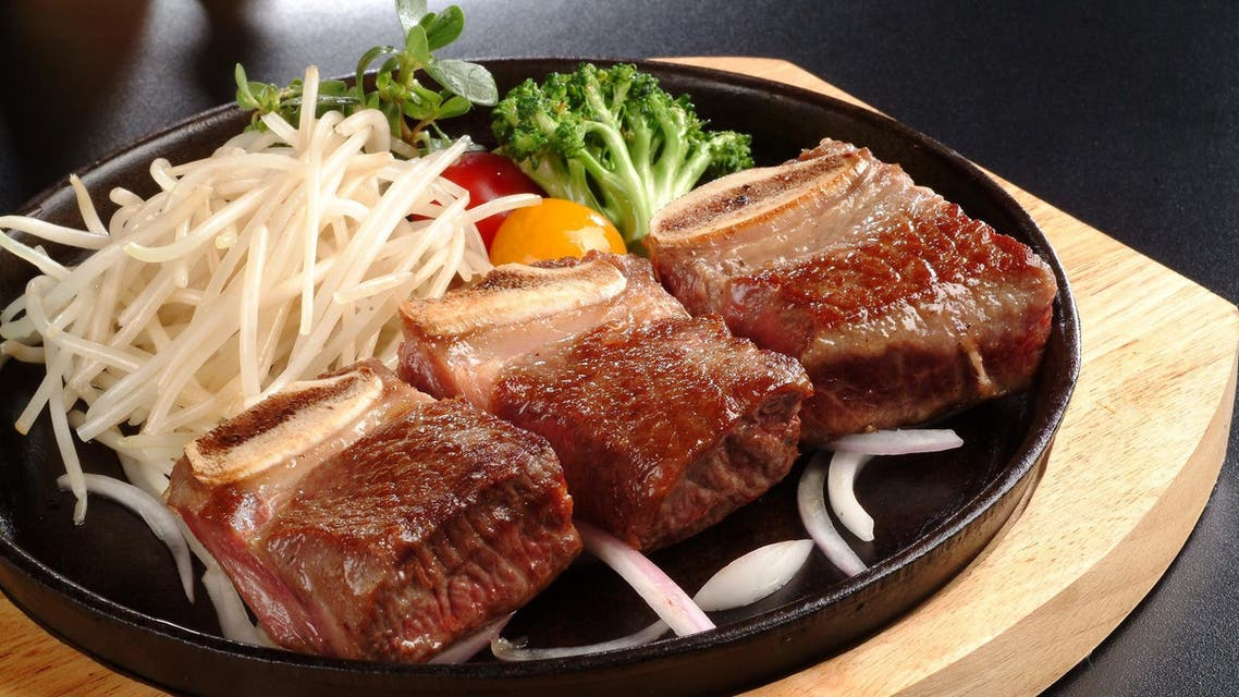 The leaders chatted over a lunch of beef short ribs, sweet and sour crispy pork, and braised codfish. (Shutterstock)
