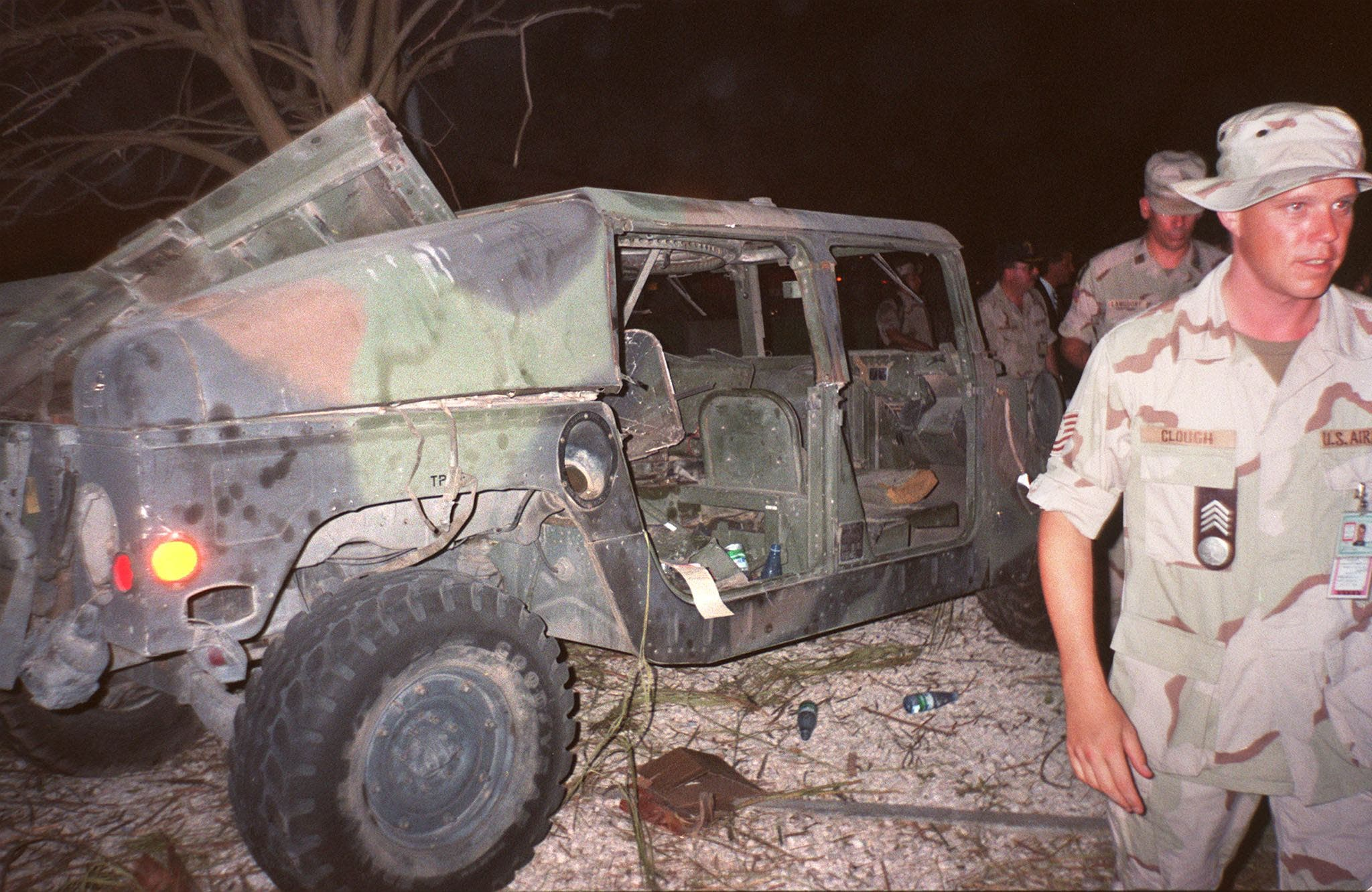 US soldiers pass by a destroyed military truck on June 26, 1996 near the site of the truck bomb which exploded on June 25, 1996 outside a military personnel housing complex in Khobar near Dhahran. (AFP)