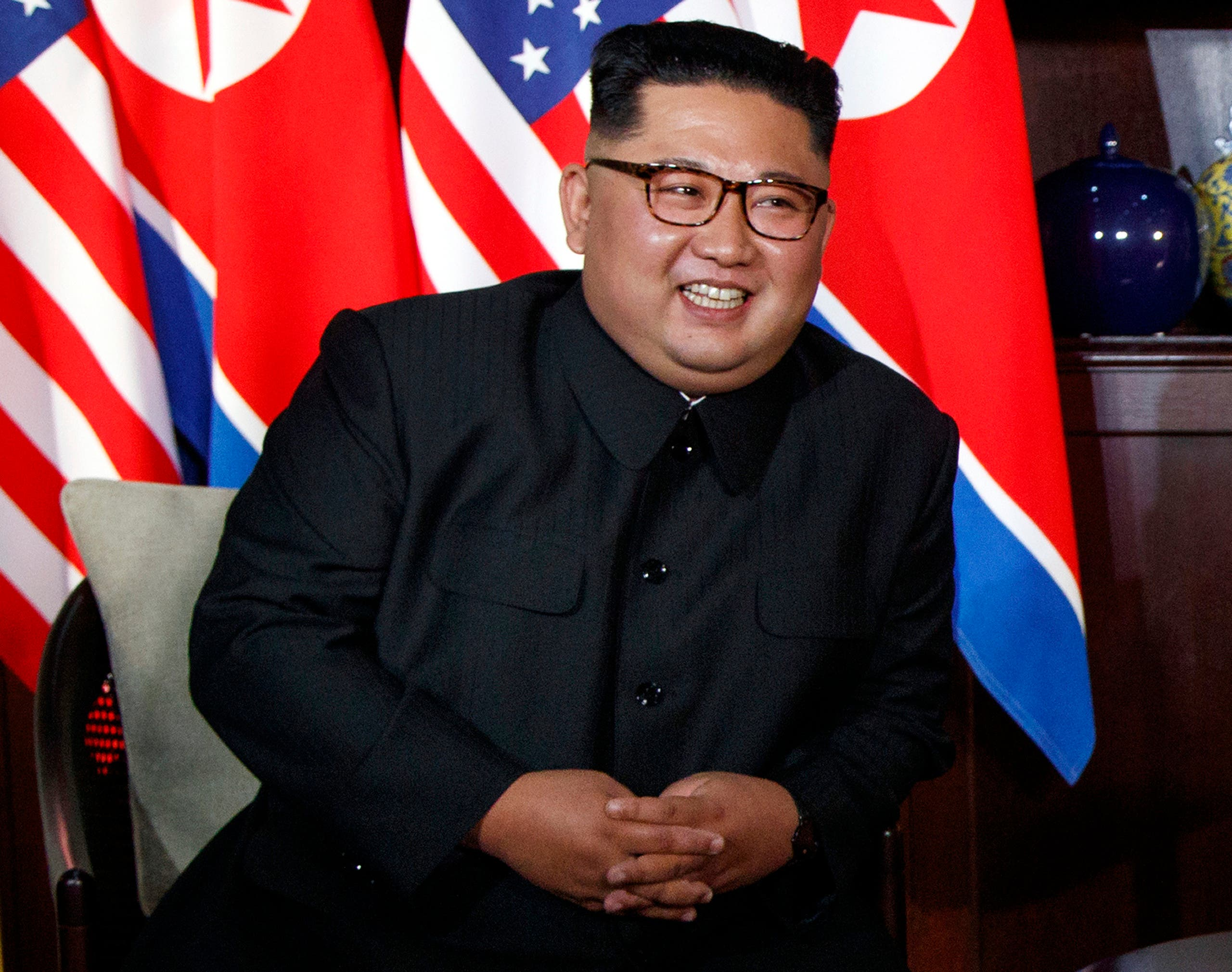 North Korean leader Kim Jong Un smiles as he meets with President Donald Trump on Sentosa Island, Tuesday, June 12, 2018, in Singapore. (AP)