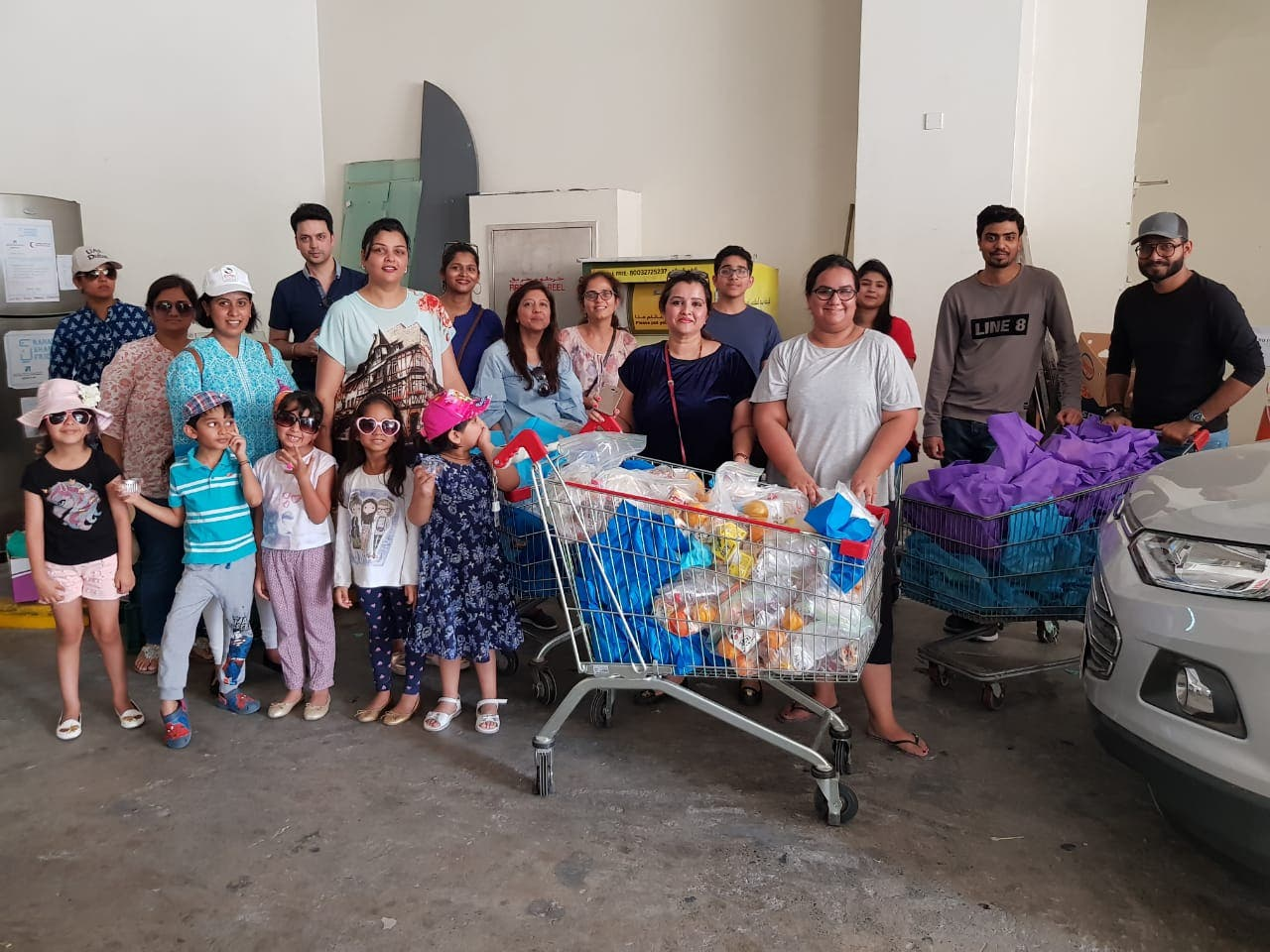 Swathi Santhosh (centre) with her Ramadan Sharing Fridges team in Dubai. The team distributed over 450 food packets to the workers everyday and plans to distribute 1000 phone calling cards to nearby labour camps for Eid. (Supplied)