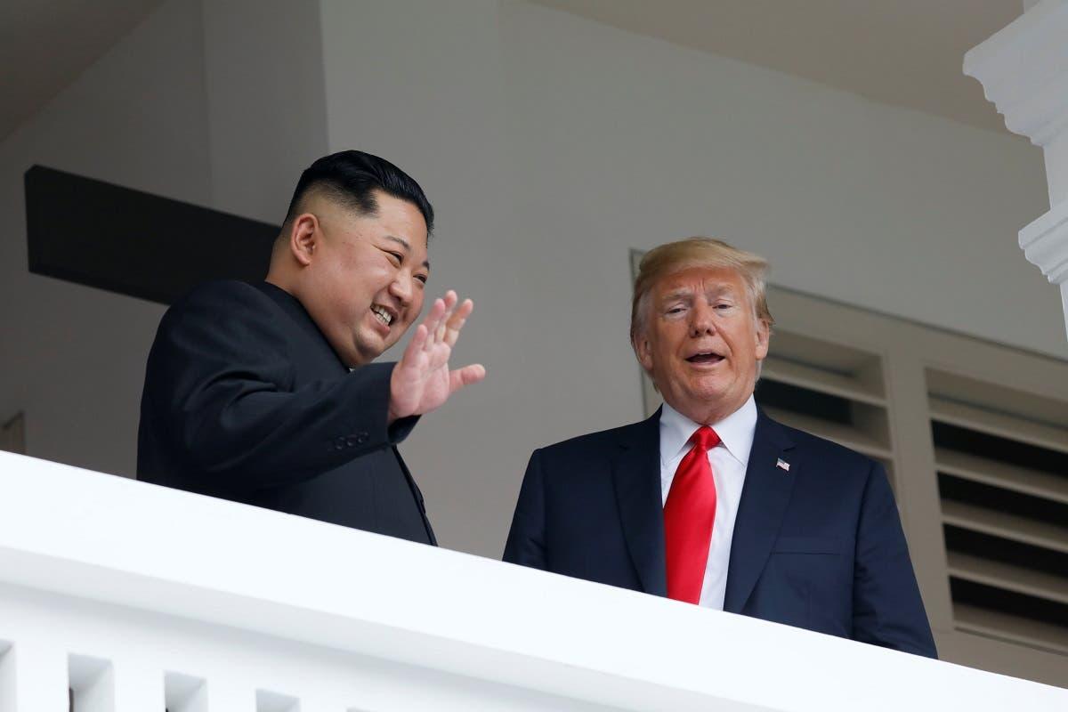 U.S. President Donald Trump talks with North Korean leader Kim Jong Un at the Capella Hotel on Sentosa island in Singapore. (Reuters)