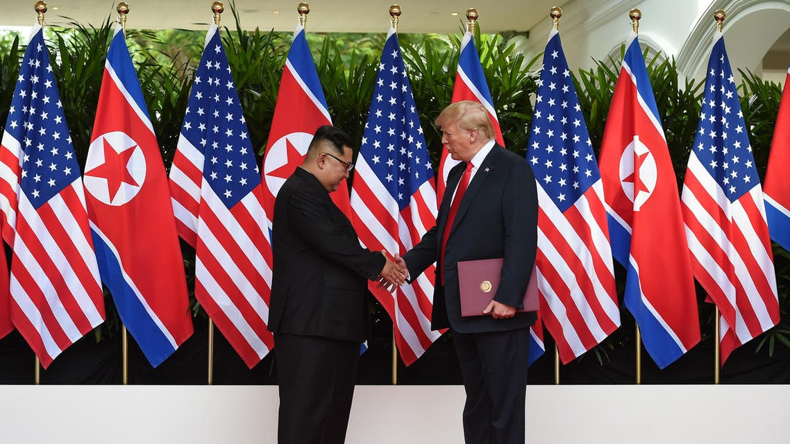North Korea's leader Kim Jong Un (L) shakes hands with US President Donald Trump (R) after taking part in a signing ceremony at the end of their historic US-North Korea summit, at the Capella Hotel on Sentosa island in Singapore on June 12, 2018. Donald Trump and Kim Jong Un became on June 12 the first sitting US and North Korean leaders to meet, shake hands and negotiate to end a decades-old nuclear stand-off. (AFP)