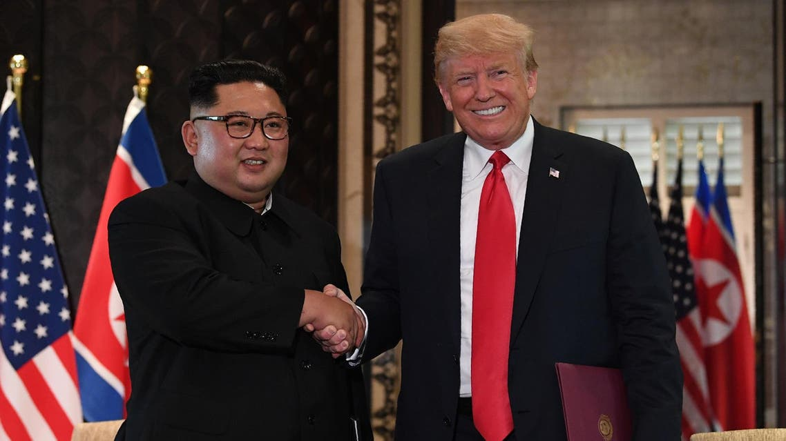 President Trump and Kim Jong Un shake hands following the signing ceremony in Singapore on June 12, 2018. (AFP)