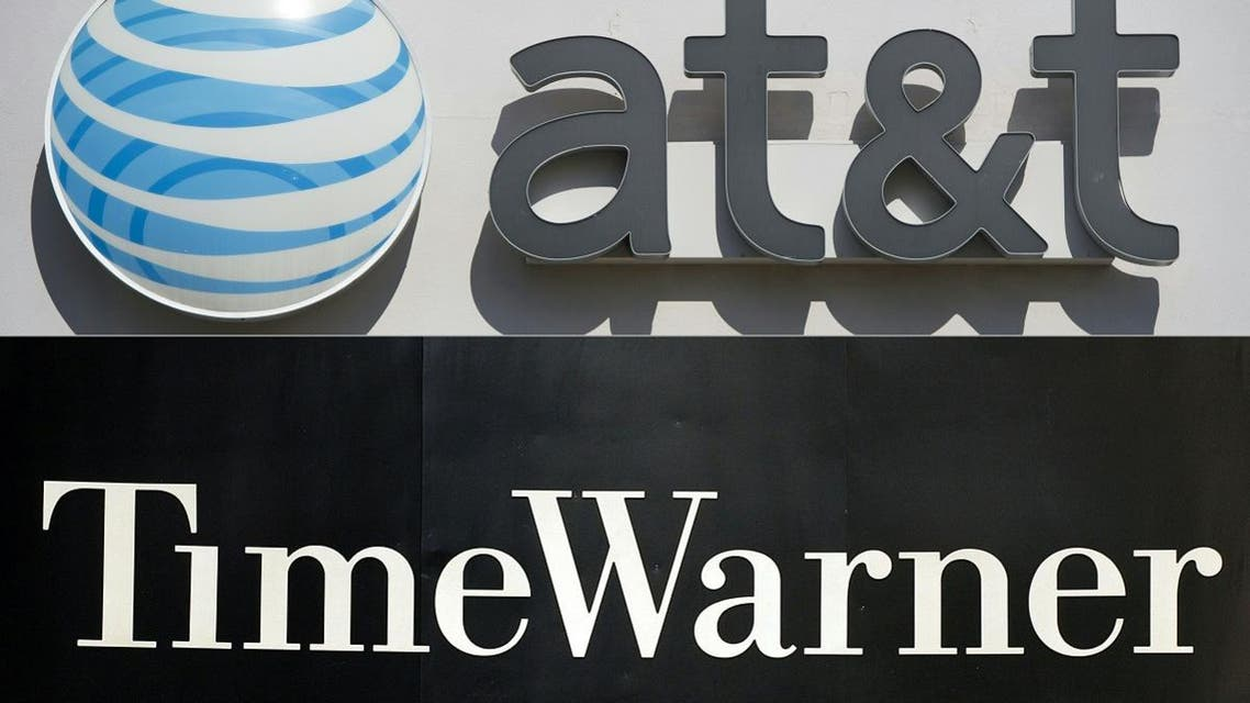 This combination of pictures created on October 21, 2016 shows an AT&T cellphone store (TOP) in Springfield, Virginia, on October 23, 2014, and the Time Warner company logo on the front of the headquarters building, 24 November, 2003 in New York. (AFP)