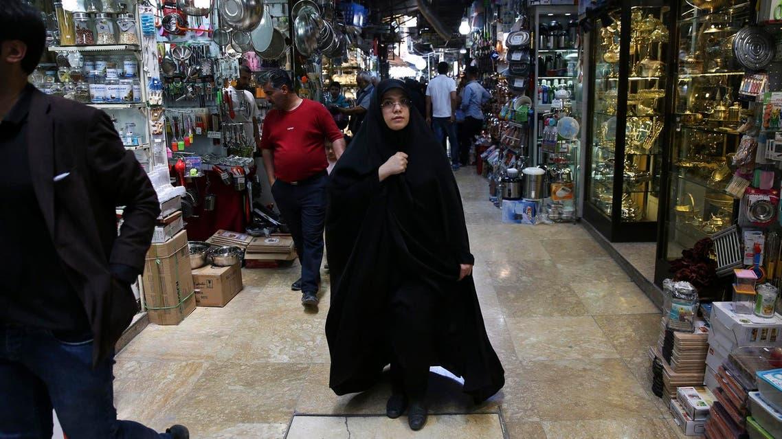 People walk through the old main bazaar in Tehran on June 9, 2018. (AP)