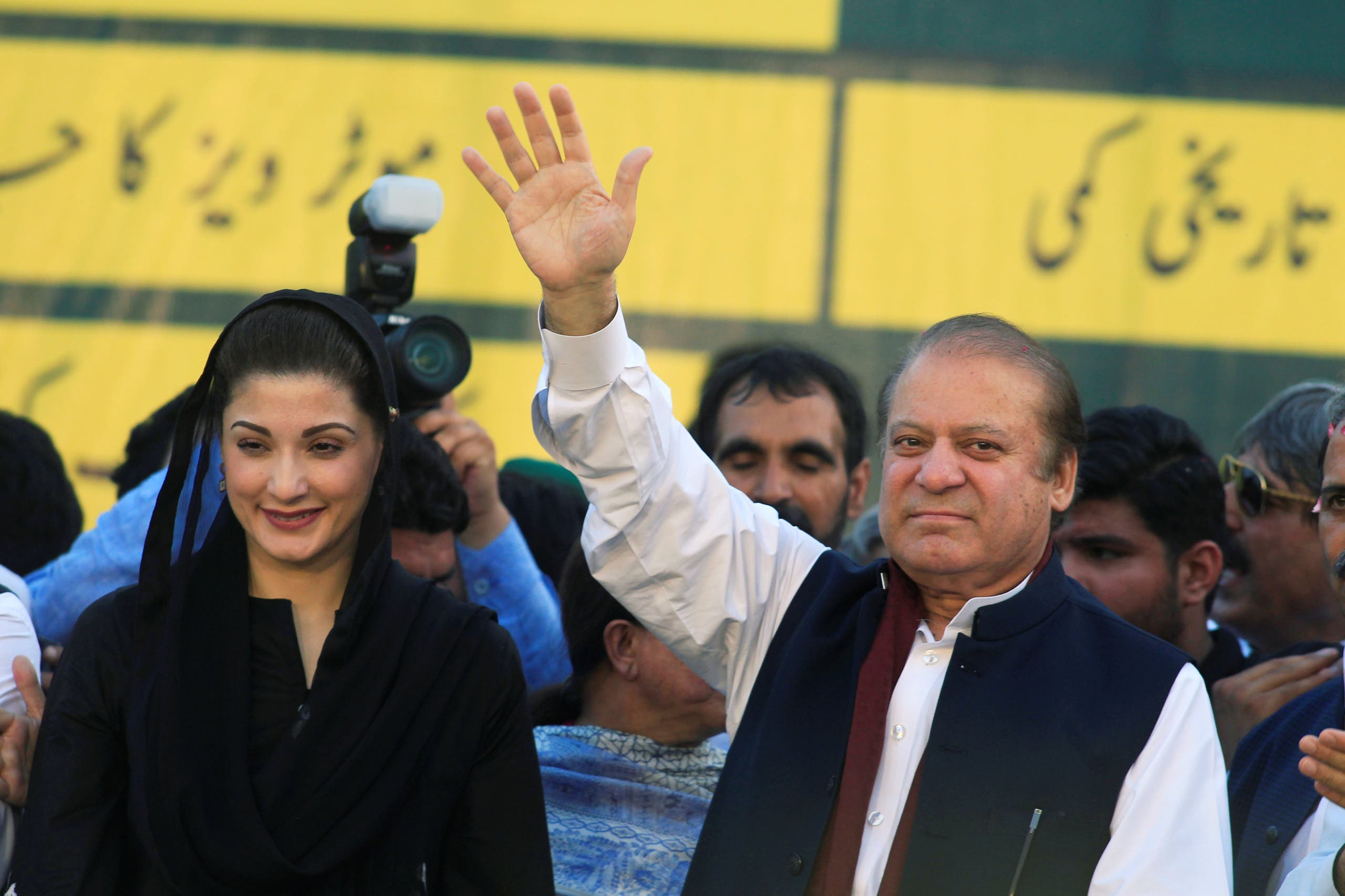 Nawaz Sharif (R), former Prime Minister and leader of Pakistan Muslim League, gestures to supporters as his daughter Maryam Nawaz looks on during party's workers convention in Islamabad on June 4, 2018. (Reuters)