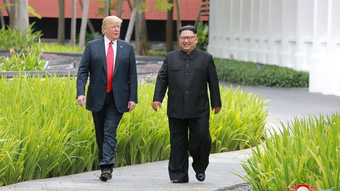 Trump walks with North Korean leader Kim Jong Un at the Capella Hotel on Sentosa island in Singapore. (Reuters)