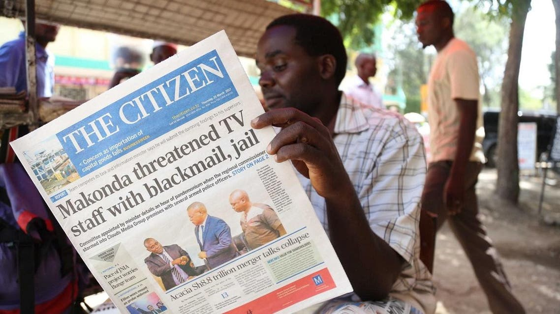 A man reads in Arusha, northern Tanzania, the local English-written daily newspaper 'The Citizen'. (AFP)