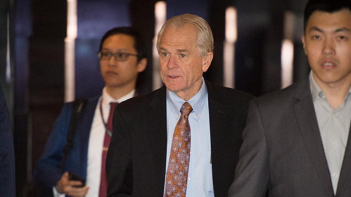 White House economic adviser Peter Navarro (C) walks through a hotel lobby as he heads to the Diaoyutai State Guest House to meet Chinese officials. (AFP)