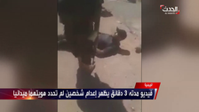 Libyan National Army brutally executes two men on a public street