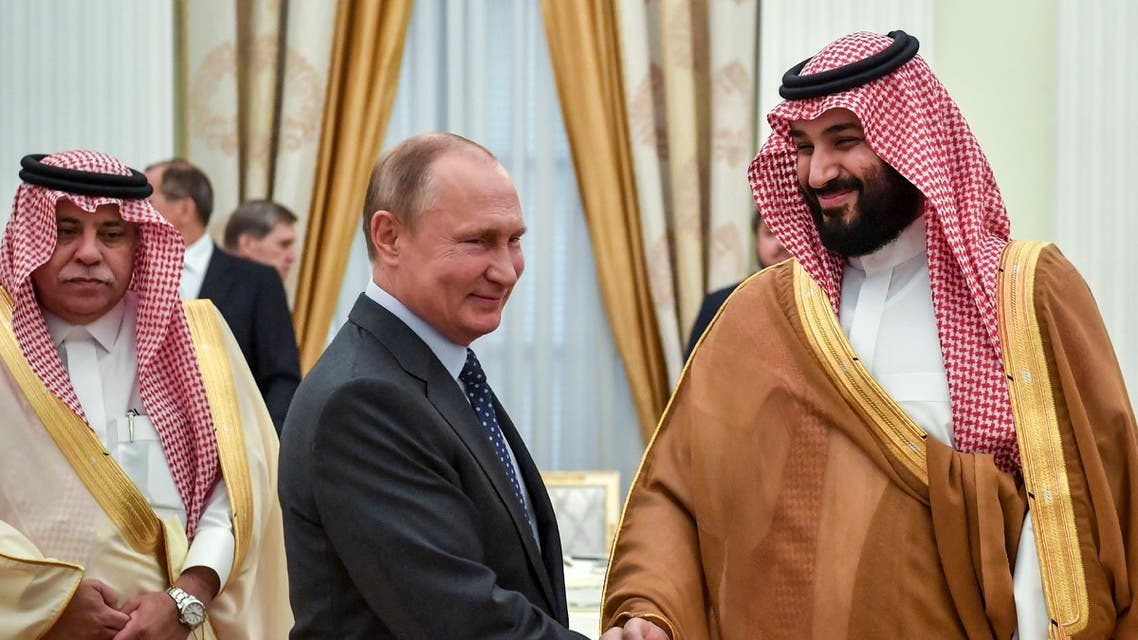 Russian President Vladimir Putin (L) shakes hands with Saudi Crown Prince Mohammed bin Salman during their meeting at the Kremlin in Moscow on June 14, 2018.