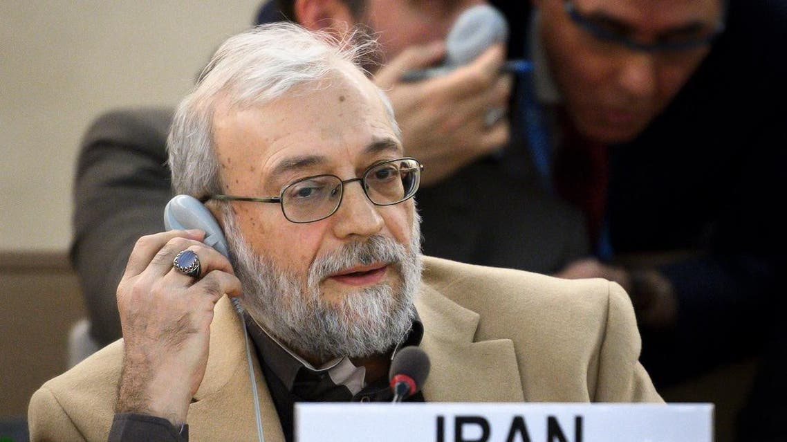 Secretary General of the High Council for Human Rights of the Islamic Republic of Iran Mohammad-Javad Larijani listens during a discussion following the report of the late Special Rapporteur Asma Jahangir on the situation of human rights in the country, in Geneva on March 12, 2018. (AFP)