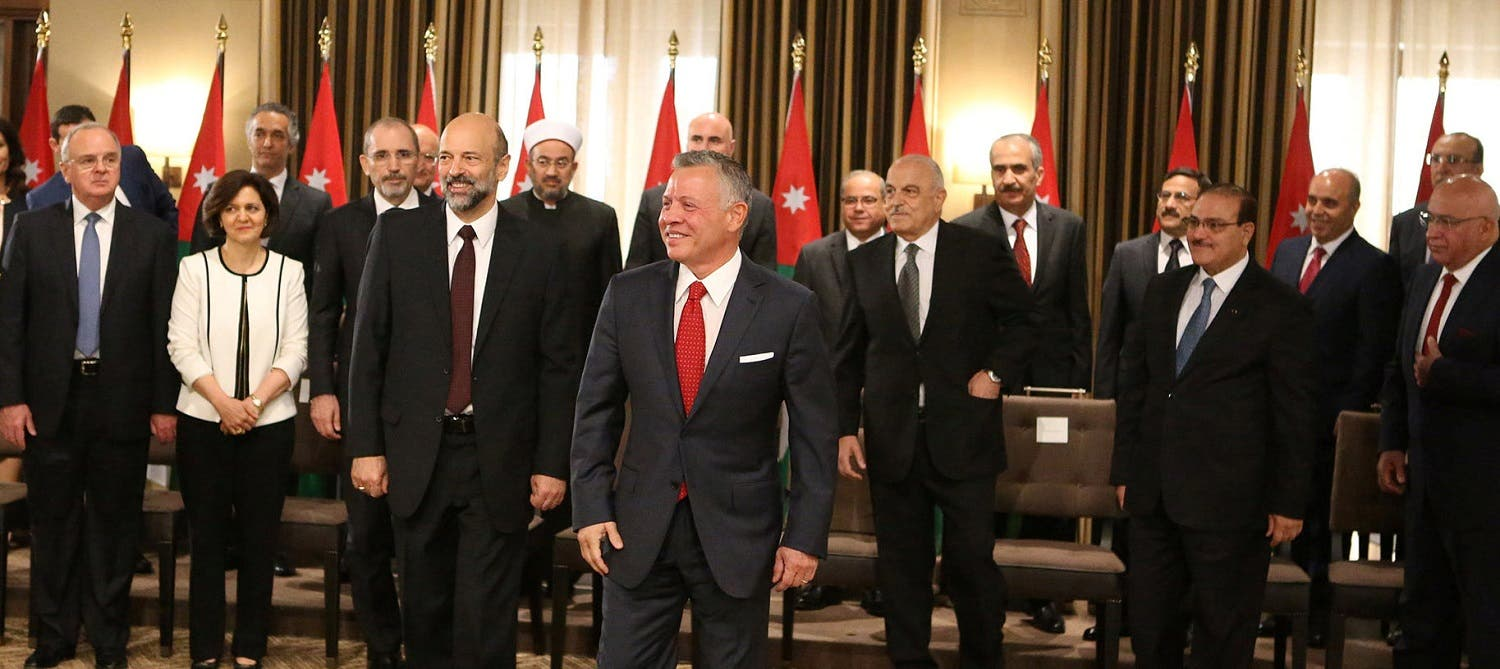 King Abdullah II stands near Prime Minister Omar al-Razzaz during a swearing-in ceremony of the new cabinet . (Reuters)