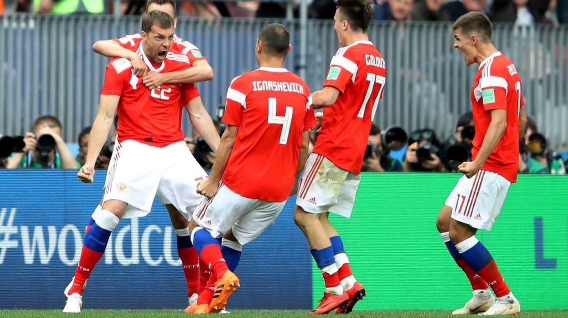 Russia's Artem Dzyuba celebrates scoring their third goal with team mates. (Reuters)