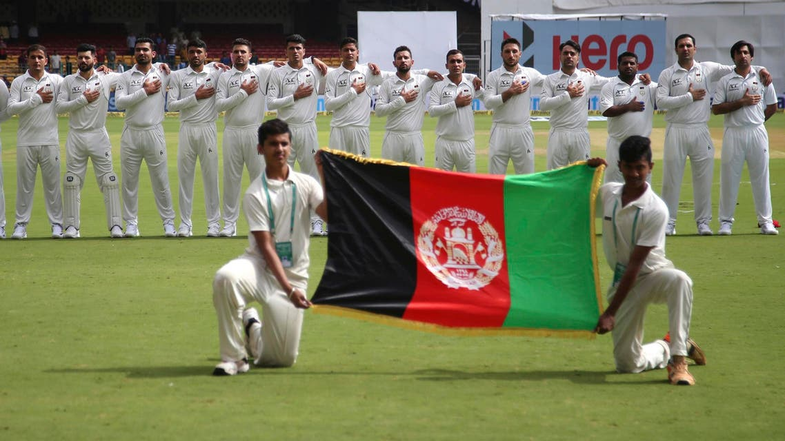 Members of Afghanistan cricket team stand for their national anthem before the start of the one-off test match against India in Bangalore on June 14, 2018. (AP)