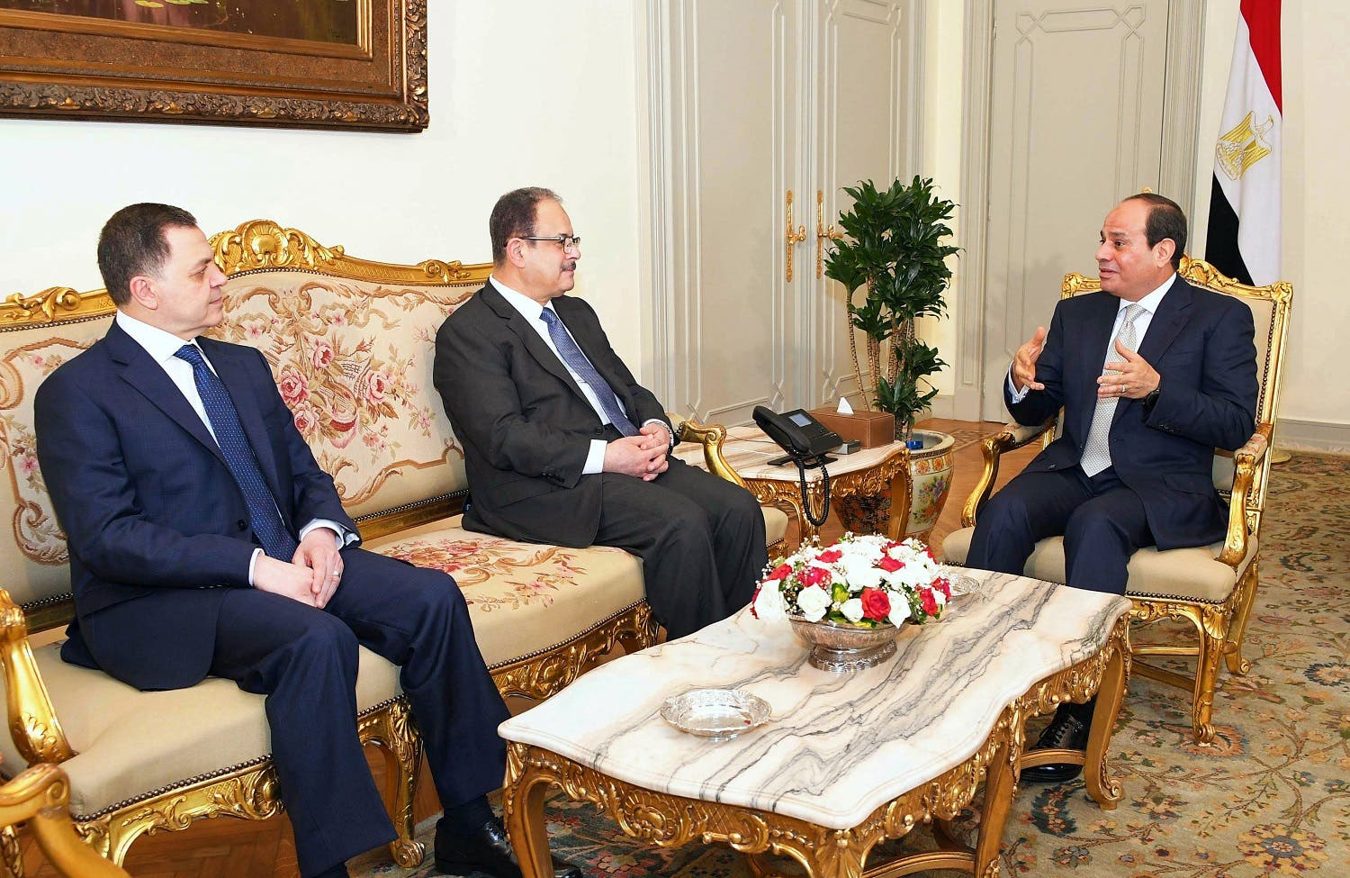 Sisi (R) meeting with his newly-appointed Interior Minister Mahmoud Tawfiq (L), and his predecessor Magdi Abdel Ghaffar (C) at the presidential palace in Cairo. (AFP)