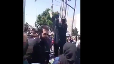 Iranian woman shouts 'Death to Khamenei' in protest of activist executions