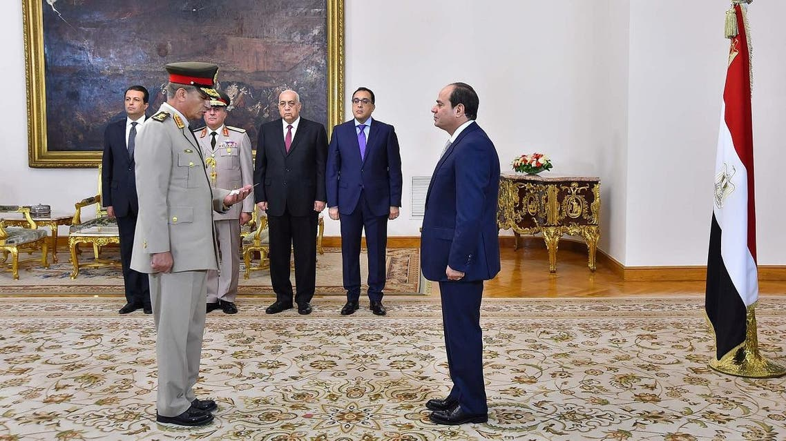 Sisi listens to the swearing in of newly appointed Defense minister General Mohamed Ahmed Zaki. (Reuters)
