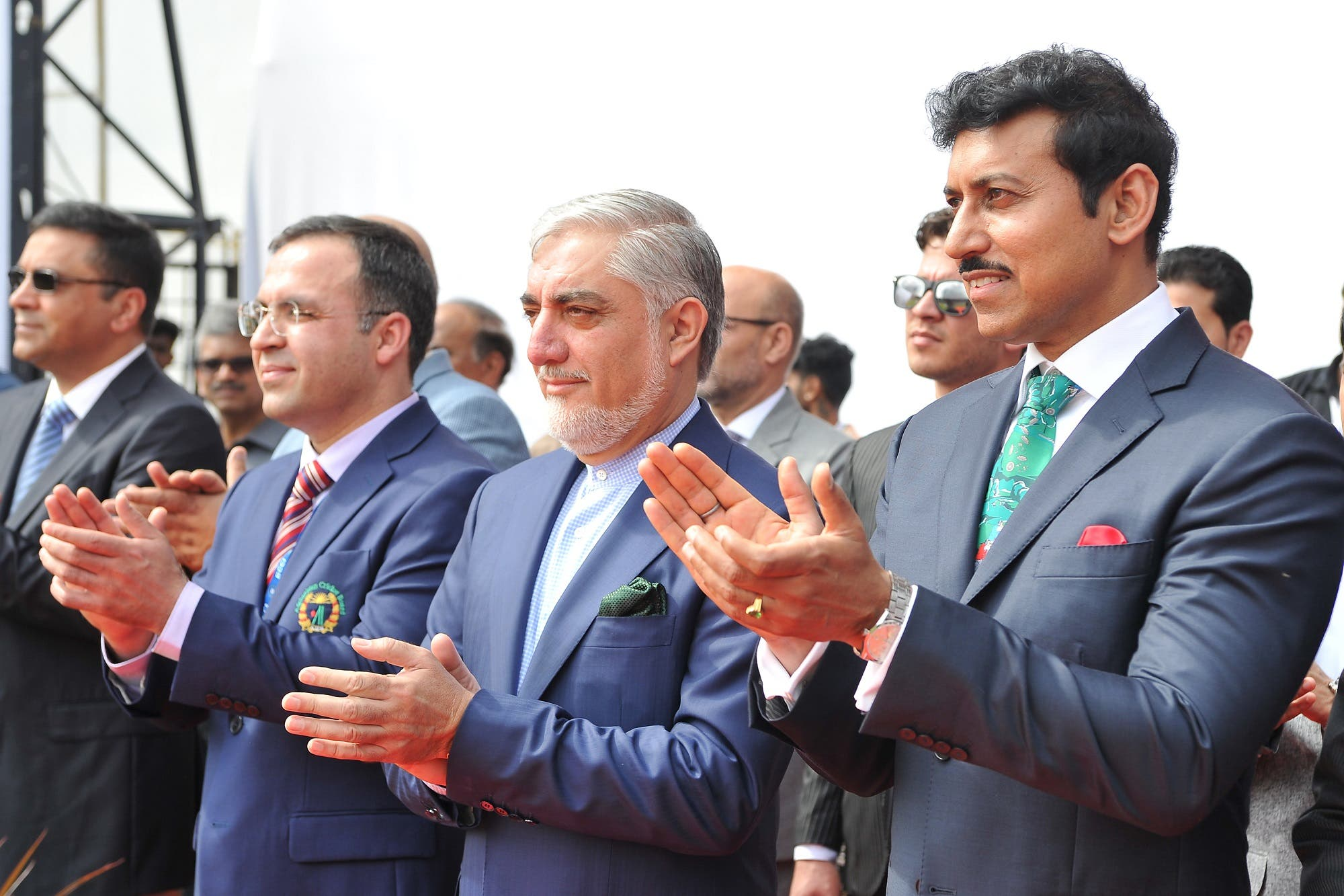 India's minister for sports Rajyavardhan Singh Rathore (R) and Afganistan's Chief Executive Abdullah Abdullah (2nd R) applaud prior to the start of the one-off Test match between India and Afghanistan in Bangalore on June 14, 2018. (AFP)