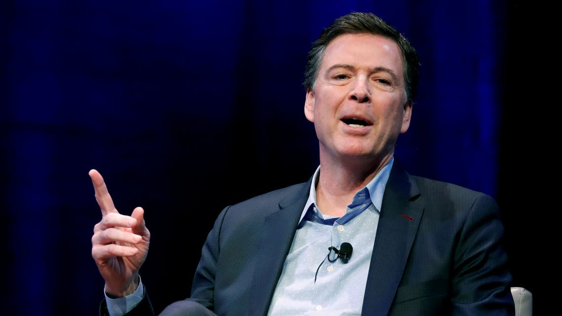 FILE PHOTO: Former FBI director James Comey speaks about his book during an onstage interview with Axios Executive Editor Mike Allen at George Washington University in Washington, U.S. April 30, 2018. REUTERS/Jonathan Ernst/File Photo