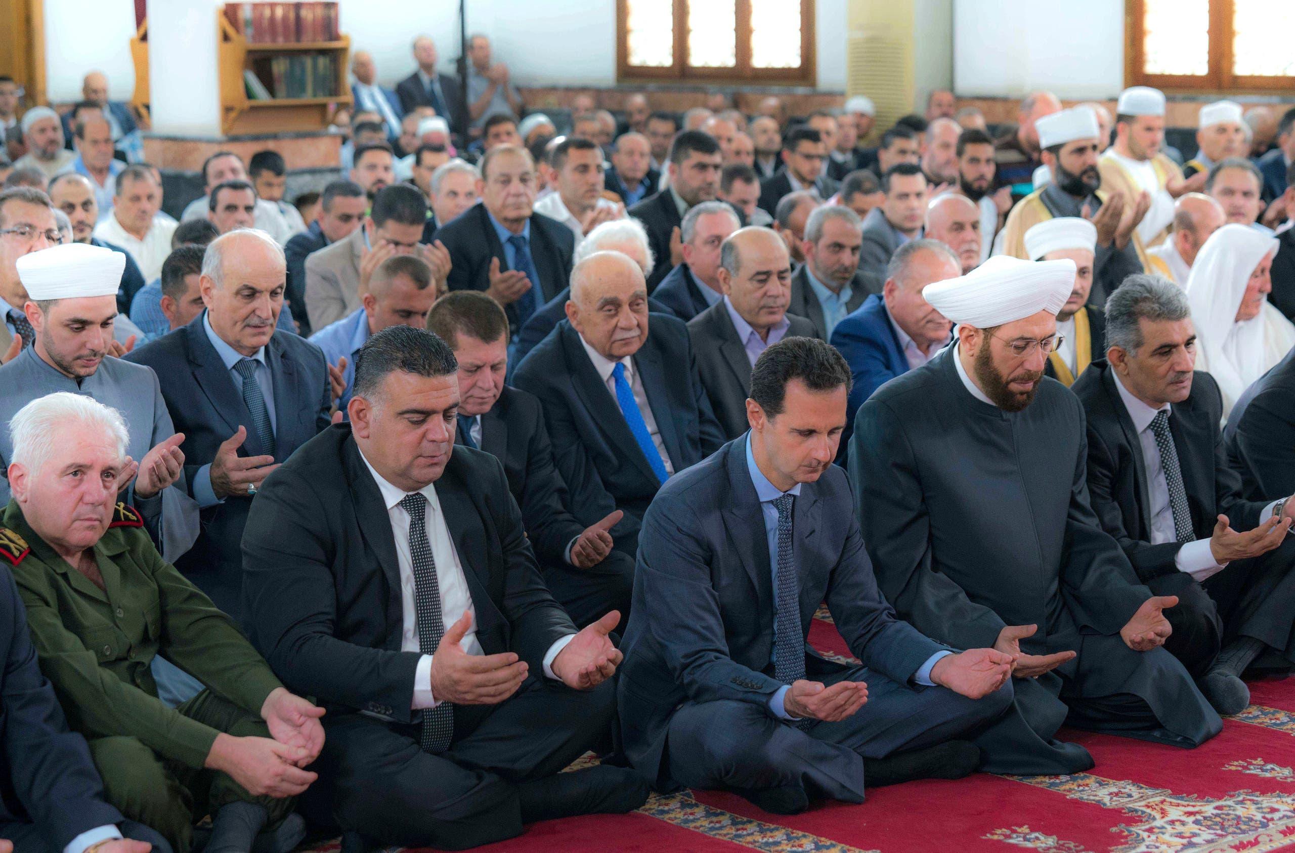 bashar assad rare appearance eid prayers. (AP)