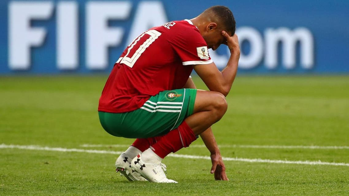 Morocco's Aziz Bouhaddouz looks dejected after the match. (Reuters)