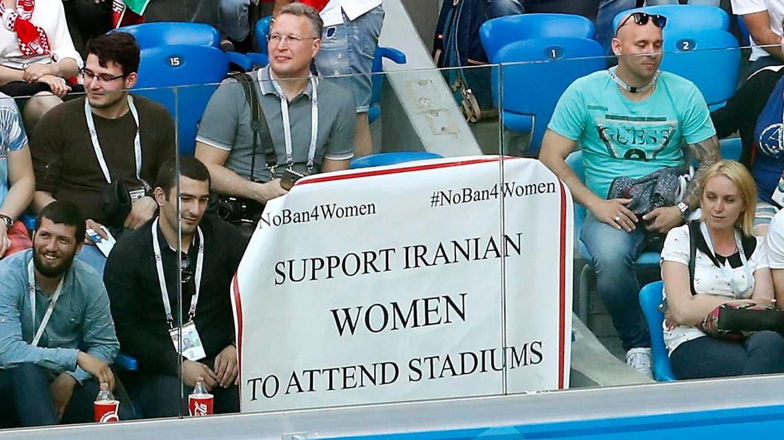 A poster to support Iranian women is displayed in the stands during the group B match between Morocco and Iran. (AP)