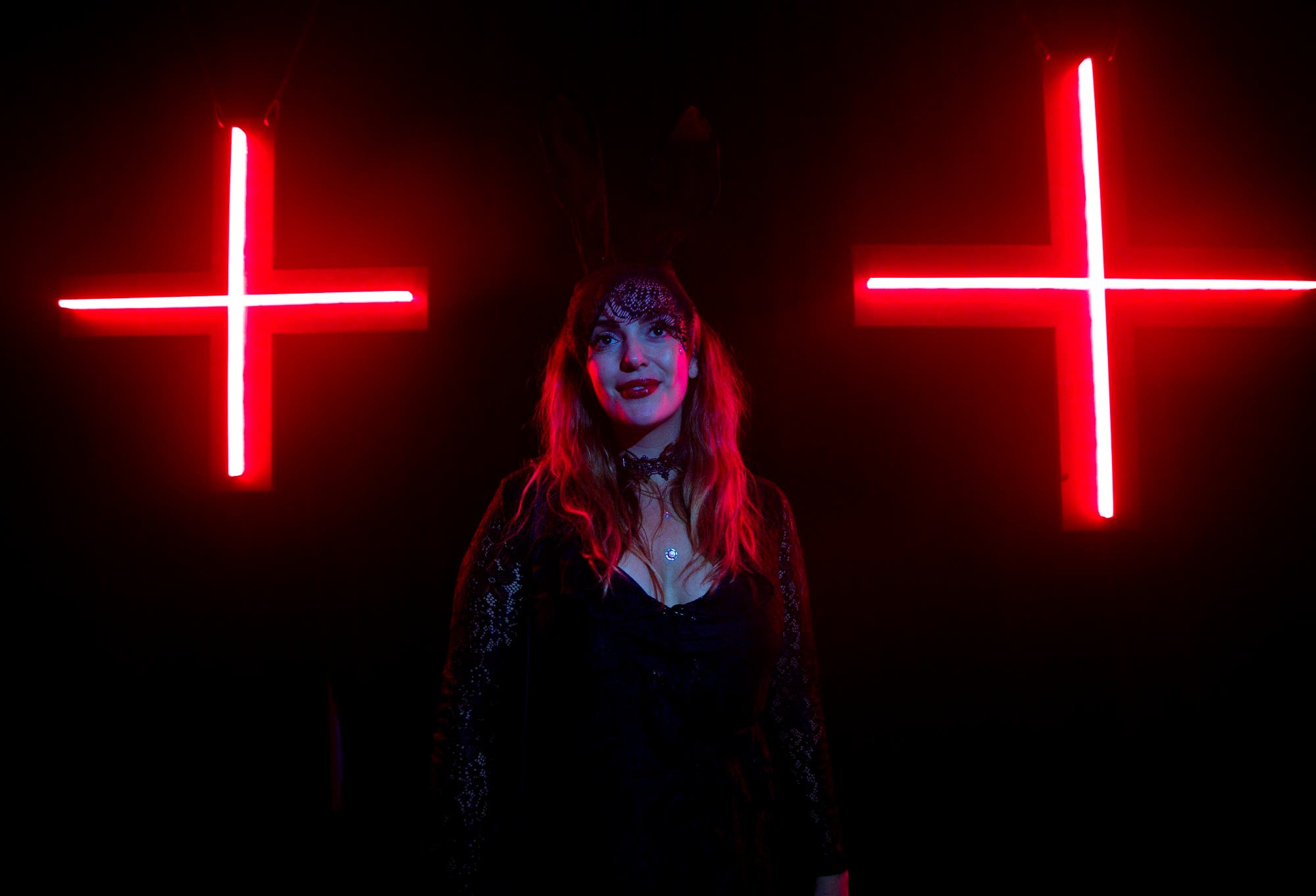 A girl stands in front of two red crosses at the entrance to the Red Bull Music Academy's event, as part of the Dark Mofo festival, in Hobart on June 18, 2017. (File photo: AP)