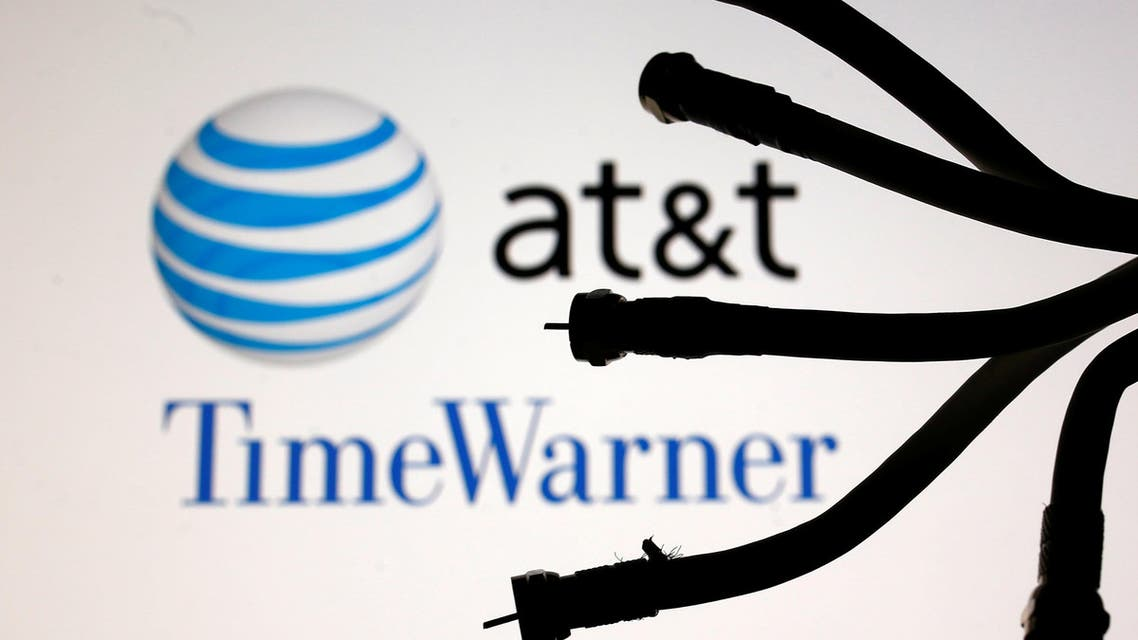 Coaxial TV Cables seen in front of AT&T and Time Warner logos in this picture illustration taken on June 13, 2018. (Reuters)