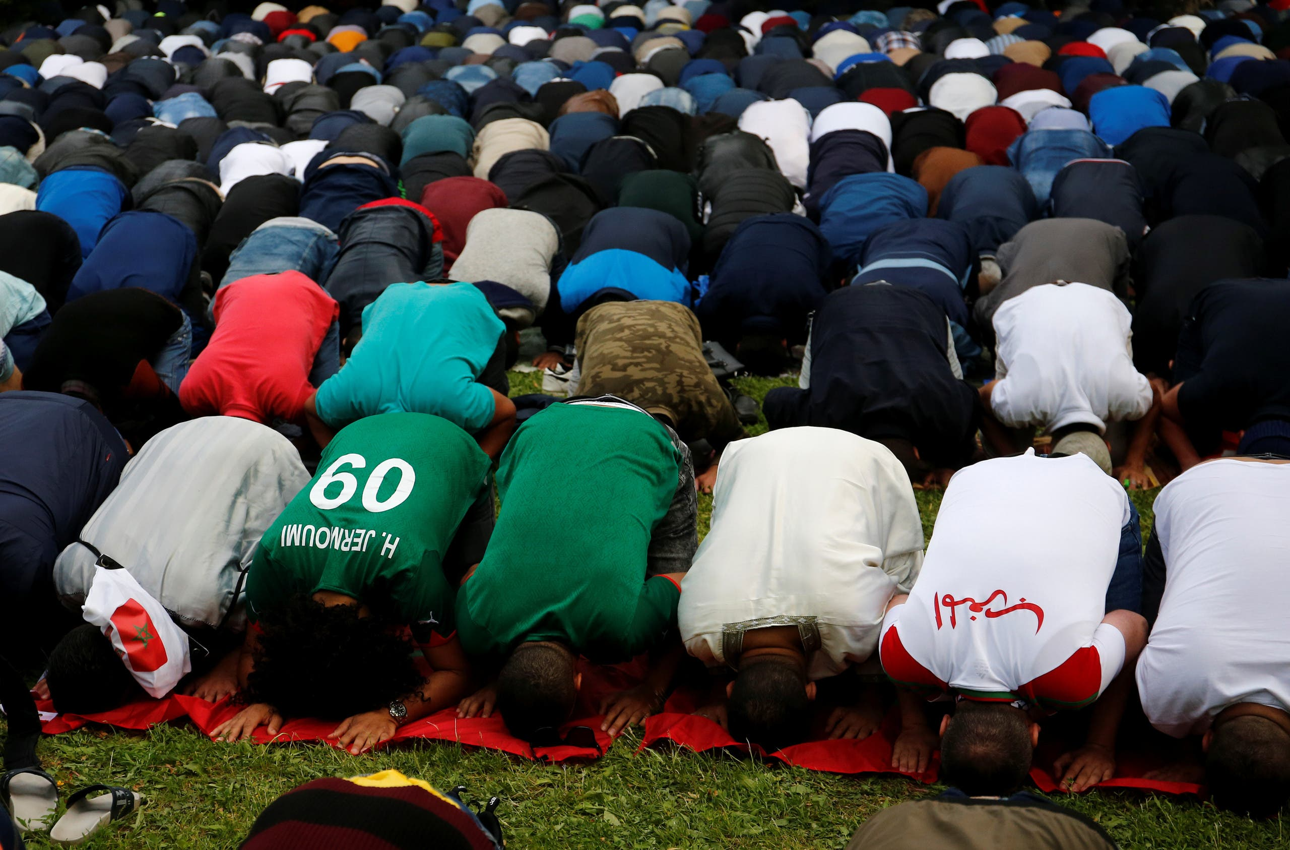 Muslims, including supporters of national soccer teams, attend an Eid al-Fitr mass prayer. (Reuters)