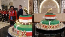 After World Cup upset, 100kg cake brings smile to Mo Salah's face