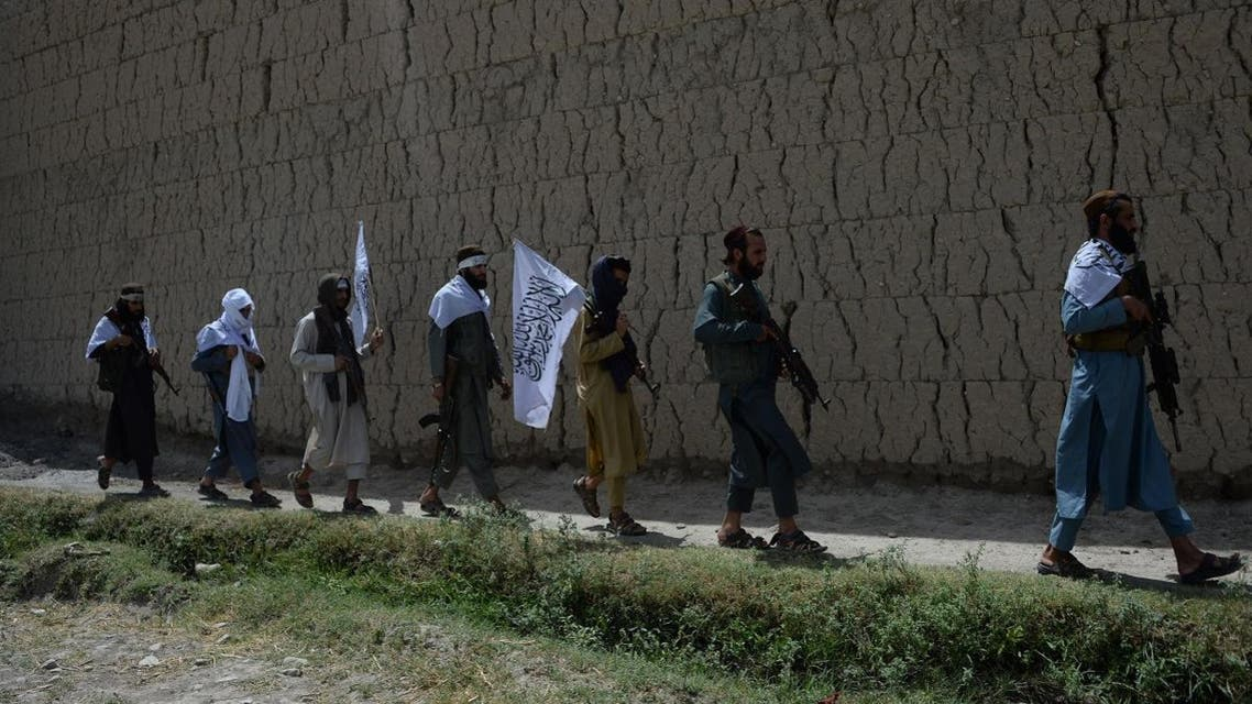 Afghan Taliban militants walk as they took to the street to celebrate ceasefire on the second day of Eid in the outskirts of Jalalabad on June 16, 2018. (AFP)
