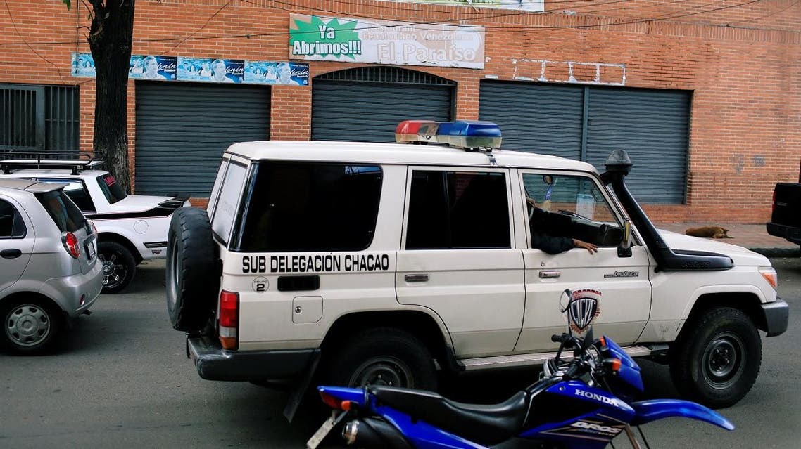 Officers of the Body of Scientific, Penal and Criminal Investigation drive past the Los Cotorros club where several people died when a person activated a tear gas grenade inside according to Venezuela's interior minister Reverol. (Reuters)