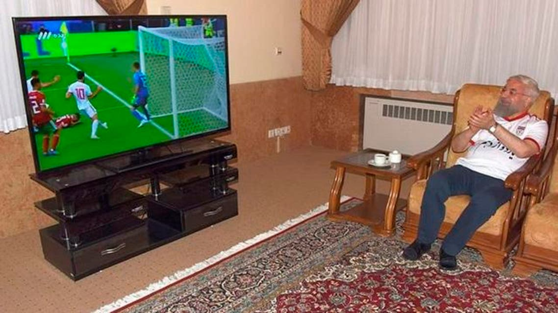 Rouhani tweeted a picture of himself clapping, wearing trousers and the national team's football shirt.