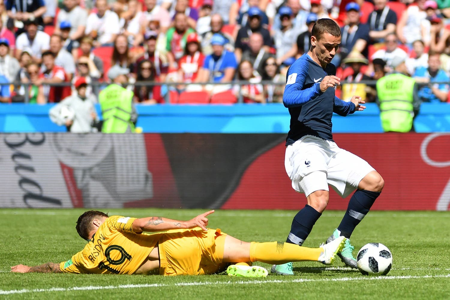 France's forward Antoine Griezmann (R) is tackled by Australia's defender Joshua Risdon giving a penalty opportunity to France. (AFP)