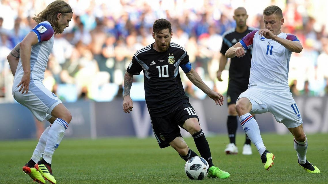 Argentina's forward Lionel Messi (C) vies with Iceland's forward Alfred Finnbogason during the Russia 2018 World Cup Group D football match. (AFP)
