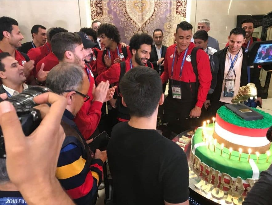 Salah smiled and hugged his team mates as they sang 'Happy Birthday' in English and Arabic before blowing out the candles. (Supplied)