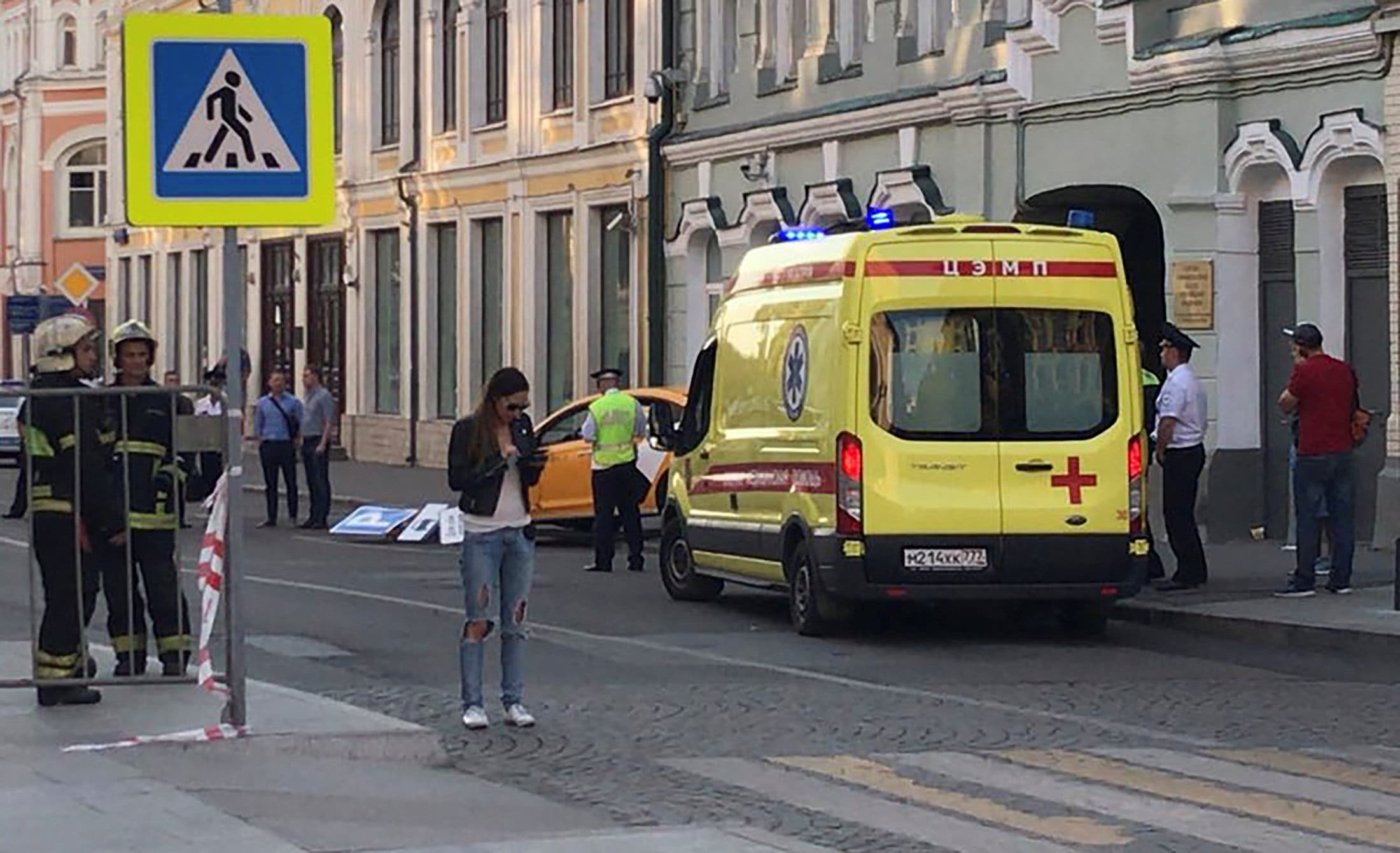 An ambulance is parked near a damaged taxi, which ran into crowds of people in central Moscow. (Reuters)