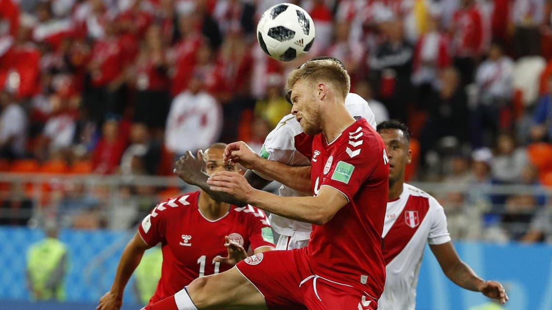Denmark's forward Nicolai Jorgensen (front C) heads the ball during the Russia 2018 World Cup Group C football match between Peru and Denmark at the Mordovia Arena in Saransk on June 16, 2018. (AFP)