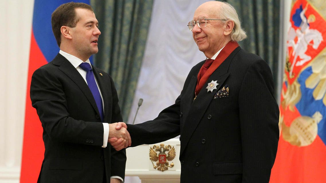 Russia's President Dmitry Medvedev (L) shakes hands with professor of the Moscow Conservatory and conductor Gennady Rozhdestvensky. (Reuters)