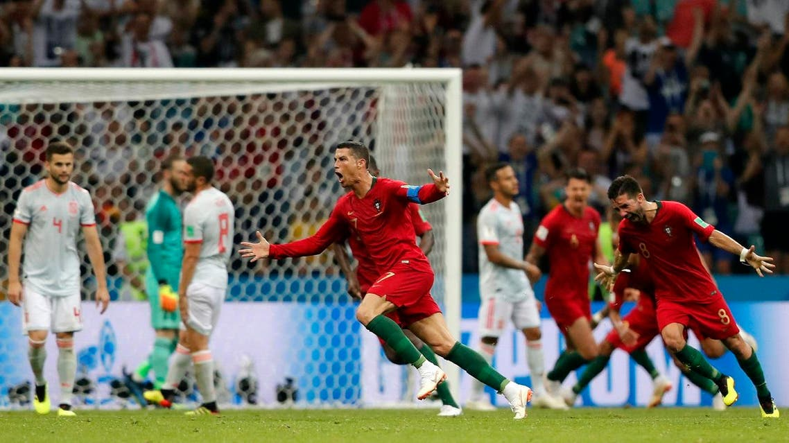Cristiano Ronaldo celebrates after he scored his third goal with a free kick during the group B match between Portugal and Spain at the 2018 soccer World Cup. (AP)