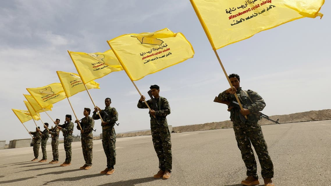 Members of the Syrian Democratic Forces (SDF), trained by the US-led coalition, participate in the graduation ceremony of their first regiment in al-Kasrah, in the suburb of eastern Syrian city of Deir Ezzor, on May 21, 2018.