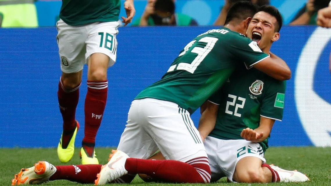Mexico's Hirving Lozano celebrates scoring their first goal with team mates. (Reuters)