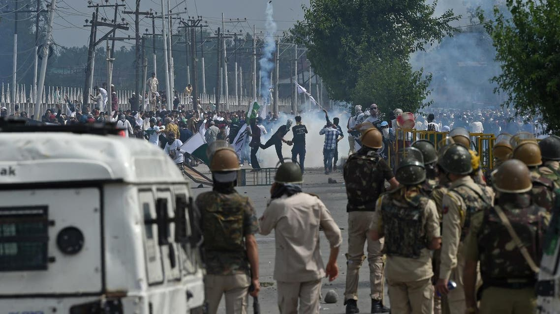 Kashmiri youths throw stones during clashes between protesters and Indian government forces in Srinagar on June 16, 2018. (AFP)