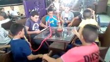 Anger over video of Egyptian children smoking shisha in a café