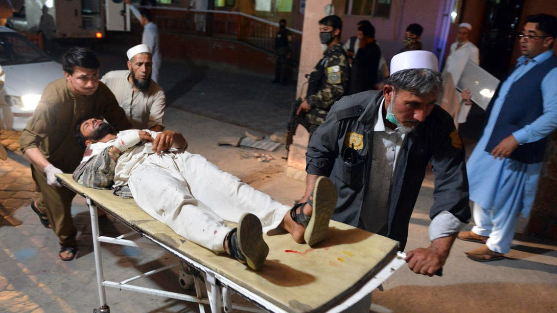 A wounded man is brought by stretcher into a hospital in Jalalabad city, capital of Nangarhar province, east of Kabul, Afghanistan, Saturday, June 16, 2018. (AP)